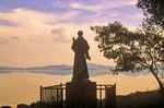 Statue of Saint Francis of Assisi on shore of Lago Trasimeno  on island of Isola Maggiore, Umbria, Italy, AGPix_0512
