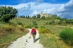 Walking tour in rural Italy on road leading to Biscina Castle, following Route of Sentiero Frescescano Della Pace, north of Valfabbrica, Umbria, Italy, APix_0513