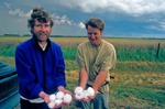 Storm chasers holding large hailstones after severe thunderstorm, near Sitka, Kansas, AGPix_0524