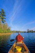 Man paddling canoe on quiet lake, Swanson's Bay, Sand Point Lake, Voyageurs National Park, Minnesota, AGPix_0538