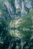 Tour boat cruising on Lake Bohinj, mirror-like reflection of mountains, Triglav National Park, Slovenia, AGPix_0560