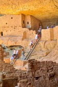 Visitors climb ladders during tour of Long House Ruins at Mesa Verde National Park, Colorado, AGPix_0570