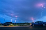 Storm chasers watch lightning storm during severe thunderstorm near Jal, New Mexico, AGPix_0592