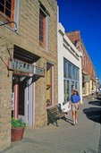 Tourist strolls through historic mining town of Jerome, Arizona, AGPix_0597