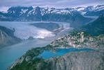 Aerial view of White Thunder Ridge with a blue pond and Riggs Glacier in background, Glacier Bay National Park, Alaska, AGPix_0658