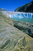 Tidewater face of Dawes Glacier with swirling pattern in metamorphic rocks on shore of the Endicott Arm of Tracy Arm-Fords Terror Wilderness Area in Tongass National Forest, Alaska, AGPix_0685
