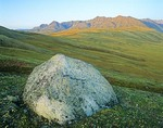 AK-02522; Jago River; Romanzof Mountains; Brooks Range; Arctic National Wildlife Refuge; Alaska; ANWR; Jago River; wilderness; tundra; glacial eratic; boulder; rock; lone; solitary; landscape; North Slope; scenic; nature; mountains; arctic tundra; vista; open; solo; AGPix_0721