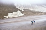 Hikers pause amid desolate landscape of ash flow in the Valley of Ten Thousand Smokes, Katmai National Park, Alaska, AGPix_0764