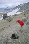 Hiker examins a fossil volcanic fumarole in the Valley of Ten Thousand Smokes, Katmai National Park, Alaska, AGPix_0765