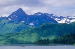 Kayakers on Lake Beverly beneath peaks of Wood River Mountains in Wood-tikchik State Park, Alaska, AGPix_0826