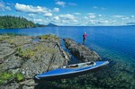 Kayak and fisherman on shore of Lake Beverly in Wood-tikchik State Park, Alaska, AGPix_0827