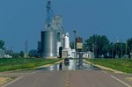 Mirage on Highway 75 with grain elevators reflected by mirage at Dumont, Minnesota, AGPix_0835