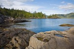 Rocky limestone shoreline of Louscoone Inlet in Gwaii Haanas National Park Reserve, in the Queen Charlotte Islands of British Columbia, Canada, AGPix_0919    