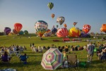 Crowds watch hot-air ballons being inflated and launched during mass ascension at National Ballon Classic, Indianola, Iowa, AGPix_0936