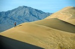 Hiker climbing on the Kelso Dunes in the Mojave National Preserve, California, AGPix_0955