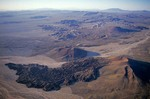 Aerial view of volcanic lava flow and cinder cone in the Mojave National Preserve, southeast of Baker, California, AGPix_0962
