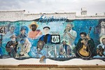 Leland Blues Mural showing local delta blues musicians, painted on building wall near Highway 61 and 10, Downtown Leland, Mississippi, AGPix_0986
