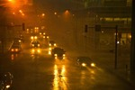 Hard rain from severe thunderstorm falls during rush hour traffic in downtown Des Moines, Iowa, AGPix_0988