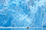 Woman kayaking near tidewater face of McBride Glacier in Muir Inlet area of Glacier Bay National Park, Alaska, AGPix_1007