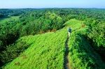 Hiker on trail at Loess Hills State Forest, a stop along Loess Hills Scenic Byway, near Pisgah, Iowa, AGPix_1046