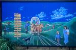 Mural celebrating pioneer history, painted on building at Marysville, Kansas, KS_00683, AGPix_1085.tif
