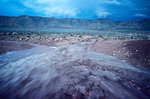 Flash flood fills desert wash after summer downpour during monsoon season, along Highway 64, Navajo Indian Reservation, Arizona, AGPix_1144