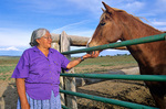 Evelyn Lewis, a Navajo woman, with her horse in corral near community of Hardrock on the Navajo Indian Nation, Arizona, AGPix_1158