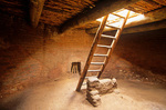 Interior of kiva with ladder leading to roof entrance, at Pecos National Historical Park, Pecos, New Mexico, AGPix_1197