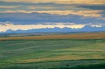 Distant Rocky Mountains rise above the Great Plains on the Blackfeet Indian Reservation, Glacier County, near Cut Bank, Montana, AGPix_1205