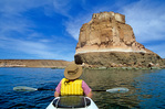 Sea kayaking near volcanic cliffs along coast of Espiritu Santo, an island in Sea of Cortez near La Paz, Baja California, Mexico, AGPix_1210
