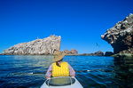 Sea kayaking at Los Islotes a small island sea bird rockery with white guano on rocks, near north tip of Espiritu Santo, an island in Sea of Cortez near La Paz, Baja California, Mexico, AGPix_1249