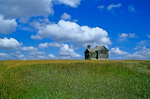 Derelict rural schoolhouse stands on prairie hilltop, Williams County south of Grenora, North Dakota, AGPix_1263