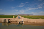 Irrigation canals flow with Colorado River water, amid lush farm fields along lower Colorado River near Poston, Colorado River Indian Reservation, south of Parker, Arizona, AGPix_1298