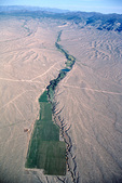 Aerial view of irrigated fields amid arid desert landscape in Snake Valley near Baker, Nevada, USA,  AGPix_1332