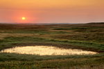 Sunset over Ordway Prairie with prairie pothole wetland, a Nature Conservancy Preserve west of Leola, South Dakota, AgPix_1423