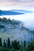 Cathedral of San Rufino emerges from morning fog that fills valley below the ancient  hilltown of Assisi, Umbria, Italy, AGPix_1431