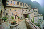 Eremo Delle Carceri, in mountain fog, a Franciscan Sanctuary associated with Saint Francis of Assisi on Mount Subasio above town of Assisi, Umbria, Italy, IT_00945, AgPix_1457