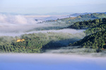 Morning fog fills the Valle Umbra,  with farms and olive groves on green hills above the valley, near Assisi, Umbria, Italy, IT_2975, AGPix_1498
