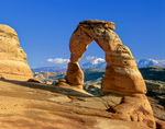 Delicate Arch at Sunset with snowy La Sal Mountains in distance, Arches National Park near Moab, Utah, UT_01995, AGPix_1567