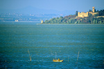 Fisherman checks his nets, Lake Trasimeno, with Isola Maggiore in back, view from lakeside town of Passignano, Umbria, Italy, IT_3255, AGPix_1636