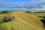 Hiker on prairie hill overlooking North Country Trail at Sheyenne National Grassland near Lisbon, North Dakota, ND_2000-00600, AGPix_1639