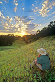 Woman watching sunset from prairie hillside along North Country Trail at Sheyenne National Grassland near Lisbon, North Dakota, ND_02073, AGPix_1640