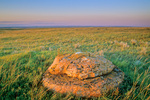 Glacial erratic boulder amid mixedgrass prairie, sunset at Grassland National Park, West Block, near Val Marie, Saskatchewan, Canada, SK_10205, AGPix_1645