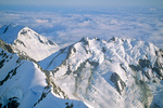 Fairweather Mountains rise above cloud layer formed over Pacific Ocean, aerial view of Glacier Bay National Park, Alaska, AGPix_1705