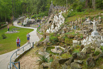 Visitor tour Ave Maria Grotto, on grounds of St. Bernard Abbey, Cullman, Alabama, AGPix_1754