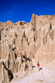 Cathedral Gorge State Park, boy hikes among eroded spires, near Panaca in eastern part of Nevada, USA, AGPix_1770