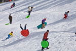 Sledding at snow play area at NAU practice field, in Flagstaff, Arizona, AGPix_1787