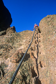 Hiking at Pinnacles National Monument, hiker using handrail on steep section of High Peaks Trail, East of Soledad, California, USA, AGPix_1820 