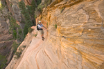 Hiker, Tom Bean, using chains for support along sheer cliff on Hidden Canyon Trail above Zion Canyon at Zion National Park, Utah, AGPix_1856