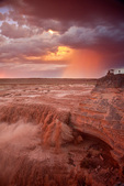 Sunset at Grand Falls on the Little Colorado River, with rain falling from summer thunderstorm in background, Navajo Nation north of Luepp, Arizona, USA, AGPix_1941